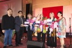 Grammy Awards Duo Cathy Fink and Marcy Maxcer, together with Barbara Lamb hold the book SabahSongs: Contemporary Music in Sabah